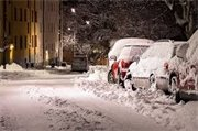 cars parked on snowy street