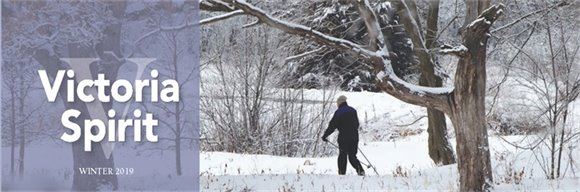 Victoria Spirit Winter 2019 with photo of person hiking in woods during winter
