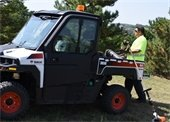 public works staff outside with bobcat vehicle