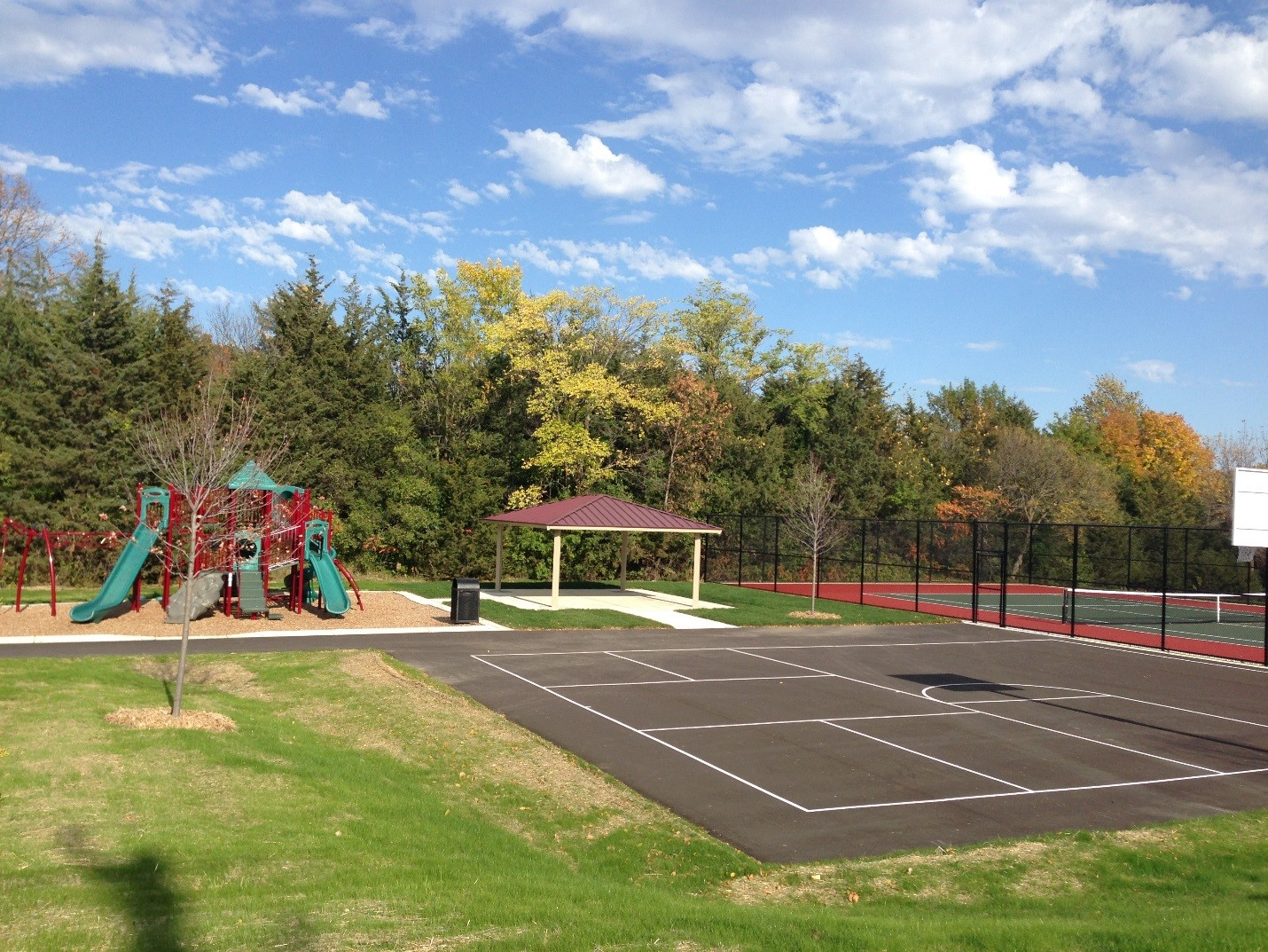 Paved Basketball Court, Shelter, and Playground